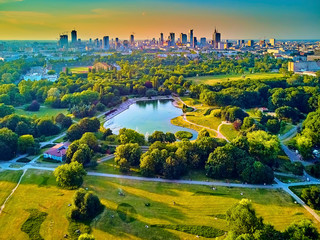 Obraz na SzkleA beautiful panoramic view of the sunset in a fabulous evening in June from drone at Pola Mokotowskie in Warsaw, Poland -