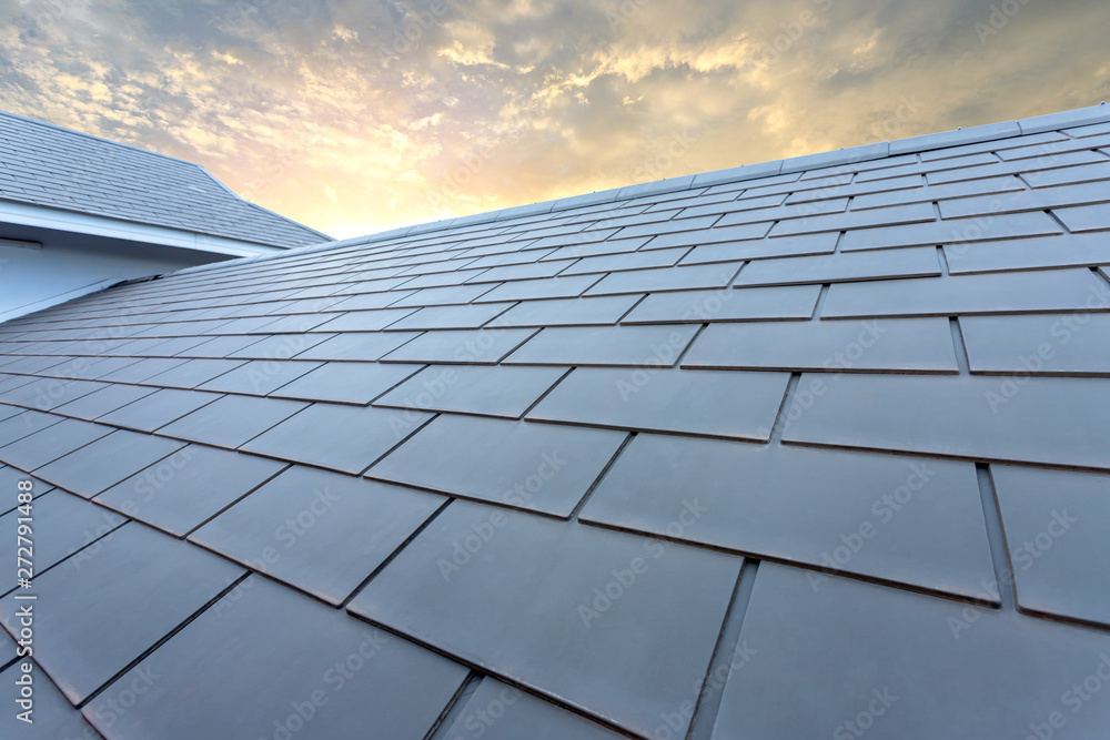 Fototapety, obrazy: Slate roof against blue sky, Gray tile roof of construction house with blue sky and cloud of the sunset background
