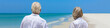 Leinwandbild Motiv Retired Senior Couple on Tropical Beach Panorama Web Banner