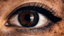 Female Fiery Eye Closeup With Gothic Makeup. Beautiful Eye