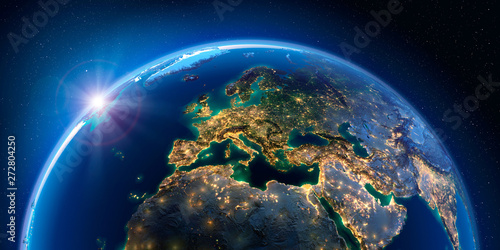 Obraz Planet Earth at night with the rising sun with the light of cities illuminating a detailed exaggerated relief. Europe. 3D rendering. Elements of this image furnished by NASA - fototapety do salonu