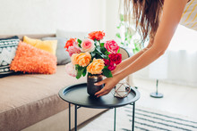 Woman Puts Vase With Flowers R...