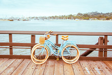 Santa Barbara Romantic Concept On Sea, Beach, Yacht Club Panorama Background. Two Retro Bicycles Standing On Santa Barbara Pier, California, USA. Vintage Filter With Muted Teal Blue And Orange Colors.