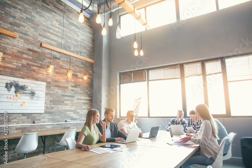 Young people having business meeting in modern office Canvas Print