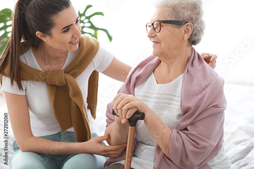 Recess Fitting Equestrian Caregiver with senior woman in nursing home