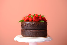 Tasty Chocolate Cake With Strawberry On Color Background