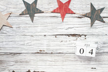 Fourth Of July Background. Wooden Stars And Wood Calendar Blocks With The Date July 4th To Mark America's Independence Day.