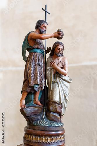 Statue of John the Baptist baptising Jesus. Wallpaper Mural