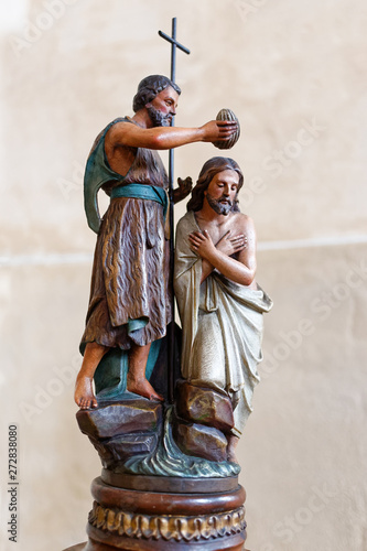 Statue of John the Baptist baptising Jesus. Canvas Print