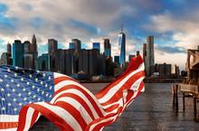 Brooklyn Bridge In New York City Manhattan And American Flag Flying