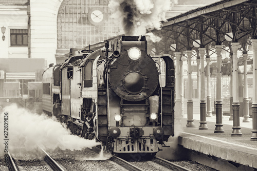 Retro train departs from railway station building. Moscow. Poster Mural XXL