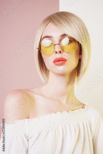 Fotobehang womenART Sensual stylish woman in erotic white dress. Blue-eyed lady with perfect lips in modern colour sunglasses
