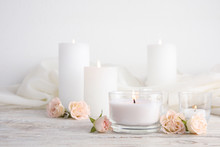 Composition With Burning Aromatic Candles And Roses On Wooden Table. Space For Text