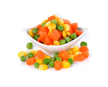 Mix Of Vegetable Containing Carrots, Peas, And Corn On White Background