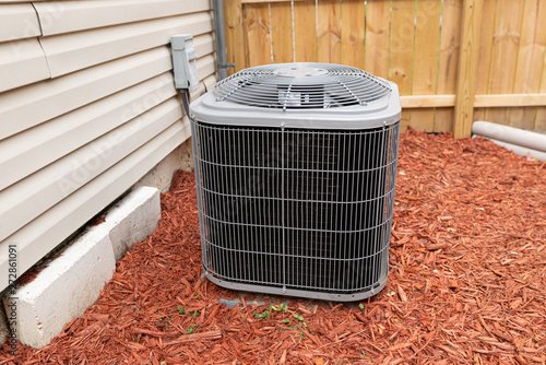 air conditioner has been properly installed and is cooling on a hot day Canvas Print