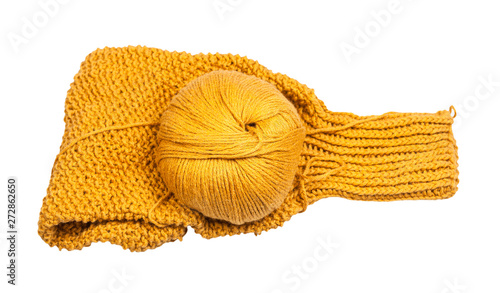 Canvastavla  skein of yellow yarn on knitted sweater sleeve