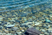 Close View Of Rocky Riverbed Under Clear Fresh Water
