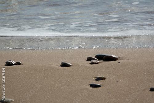 Foto auf Leinwand Texturen Steine an einem Strand