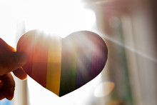 Heart Rainbow Colors In Hand Lgbt Flag Against The Window Sun Rays