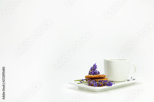 Foto auf Gartenposter Lavendel Morning cup of coffee with wafers and lavander decoration
