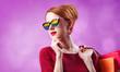 Leinwandbild Motiv Redhead woman in sunglasses with rainbow and with shopping bags