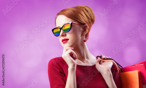 canvas print motiv - Masson : Redhead woman in sunglasses with rainbow and with shopping bags