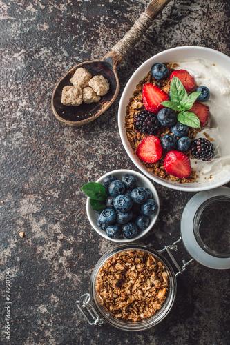 Healthy breakfast with granola, yogurt, fruits, berries on dark metal background. Summer homemade breakfast. - 272901045