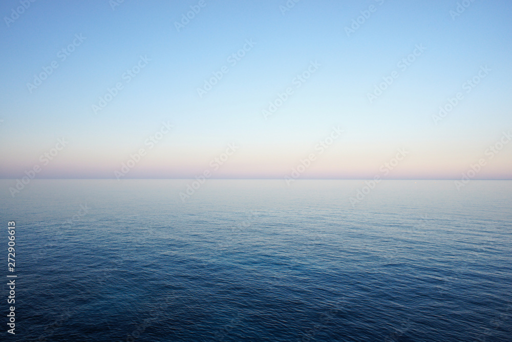 Fototapety, obrazy: Seascape in delicate pastel colors with the horizon of the sea and clear sky early in the morning. Mediterranean Sea