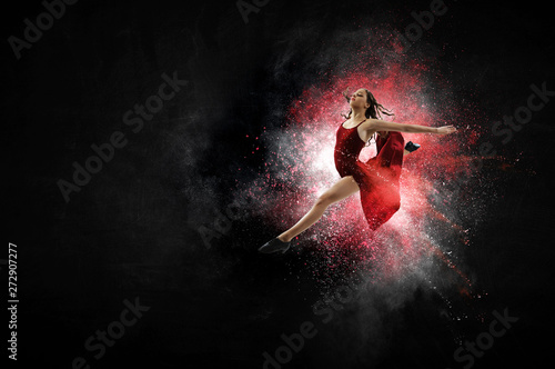 Fotografering Young and beautiful female dancer in a red dress. Mixed media
