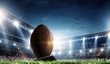 canvas print picture - Night football arena in lights with a ball close up