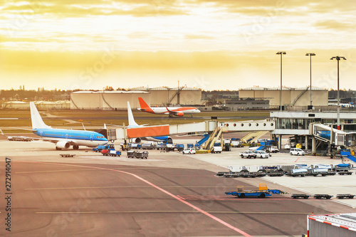 Fotografering  Airport with airplanes at the terminal gate ready for takeoff, international air