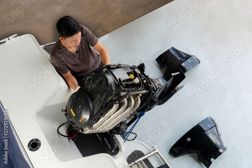 Aluminium Prints F1 Repairing engines on aluminum boats , The technician is removing the boat parts to make the paint
