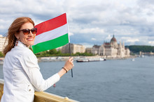 Happy Young Woman Holding Hungarian Flag At Budapest