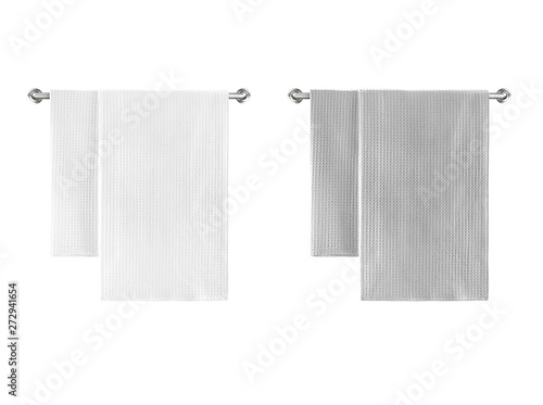 Fotografia  White and grey cotton terry towels hanging on a rail isolated