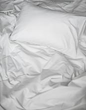 White Messy Bed Top View