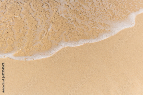 Stickers pour portes Eau Close up of soft wave of ocean on the sand, background.