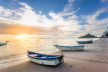 Boat By The Beachside During Beautiful Sunrise