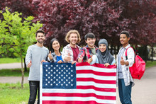 Group Of Students With USA Flag Outdoors