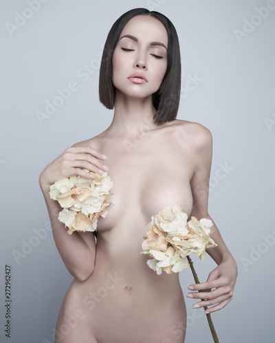 Poster womenART Fashion art photo of elegant nude model with the summer flowers