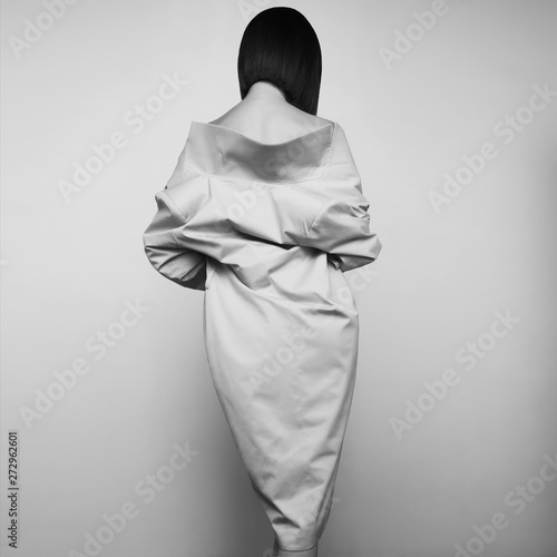 Fotobehang womenART Beautiful sexy woman in white autumn coat. Fashion art portrait.