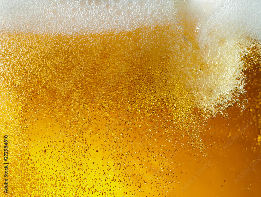 Fototapety, obrazy: Close up view of floating bubbles in light golden colored beer background. Texture of cooling summer's filtered drink with foam and macro fizz on the glass wall. Fizzing or floating up to top of