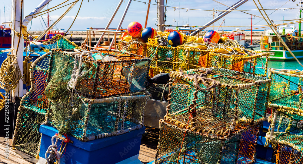 Fototapety, obrazy: Crayfish nets and traps on a small fishing boat