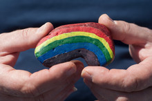 Closeup Of Rainbow Painting On Stone Pebble In Hand