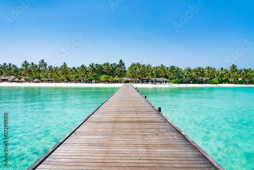 Wooden pier at a tropical island luxury resort