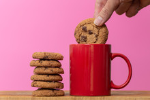 Dunking A Biscuit In To A Cup Of Coffee Or Tea