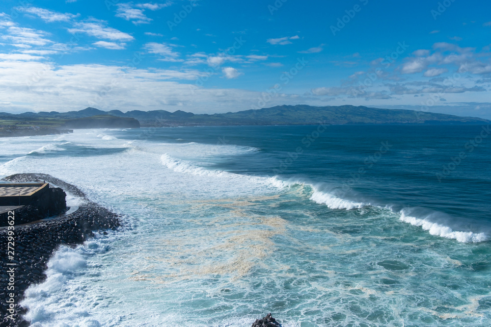 Amazing view of Atlantic Shore at Ribeira Grande. Blue water and clouds. Island of Sao Miguel, Azores Islands, Portugal, Europe - obrazy, fototapety, plakaty
