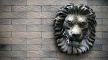 Lion Head Knocker On Brick Wall