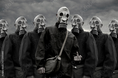 Fotografie, Obraz  Soldiers in gas mask against stormy sky background
