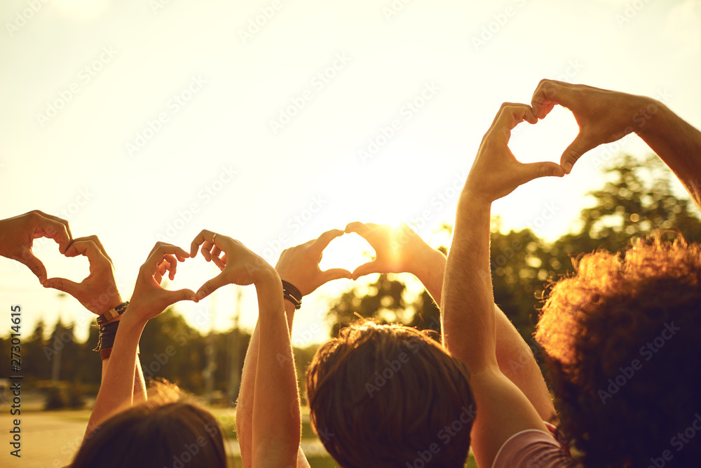 Fototapety, obrazy: Hands of group friends in the shape of a heart against the sunset.