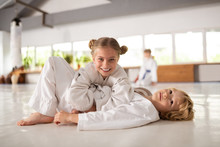 Brother And Sister Feeling Happy Practicing Aikido Together